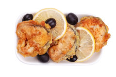 Grilled fish with olives and lemon Royalty Free Stock Image