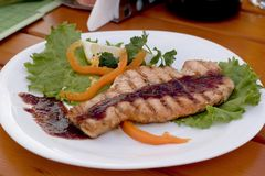 Grilled fish on plate. Grilled fish on white plate Stock Photo