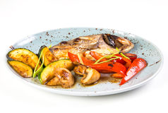 Grilled fish on plate. With grilled vegetables isolated on white Stock Photo