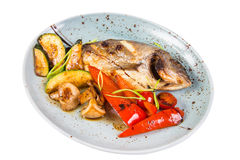 Grilled fish on plate. With grilled vegetables isolated on white Royalty Free Stock Image