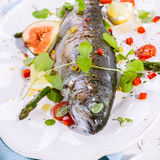 Grilled Fish on Platter with Garnish and Seasoning Stock Photos