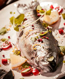 Grilled Fish on Platter with Garnish and Seasoning Royalty Free Stock Photography