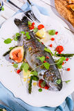 Grilled Fish on Platter with Garnish and Seasoning Royalty Free Stock Image
