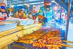 Grilled fish and pork in Talad Saphan Phut market, Bangkok, Thailand