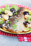 Grilled fish with potatoes Stock Images