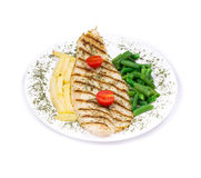 Grilled fish with potatoes and peas Stock Images