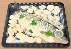 Grilled fish, Recipe 3 (series). Fish with potatoes on braziers ( recipe 3 Royalty Free Stock Images