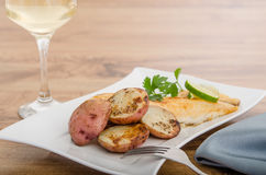 Grilled fish with red potatoes Stock Photo