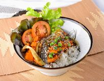 Grilled fish with rice, soy sauce on wooden background stock photo