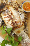 Grilled fish with salt Royalty Free Stock Images