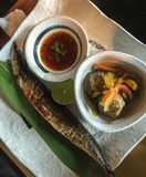 Grilled fish with sauce. At Japanese restaurant stock photos