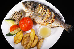 Grilled fish sea bream on barbecue Royalty Free Stock Images