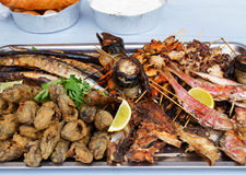 Grilled fish, shrimp, mussels and seafood sticks. Street food. Royalty Free Stock Photo