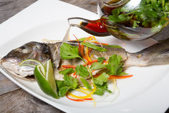 Grilled fish with soy sauce Royalty Free Stock Photos