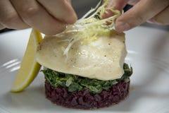 Grilled fish steak onl vegetables and lemons Stock Photos