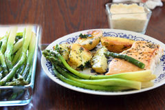 Grilled fish steak with potatoes and asparagus Stock Image
