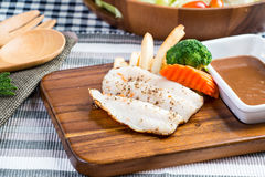 Grilled fish steak. Set with Cesar Salad Royalty Free Stock Image