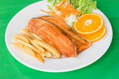 Grilled fish steaks salad. A grilled fish steaks salad Stock Image