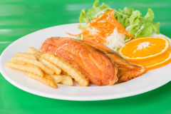 Grilled fish steaks salad. A grilled fish steaks salad Stock Images
