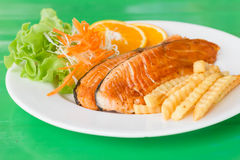 Grilled fish steaks salad. A grilled fish steaks salad Royalty Free Stock Photography