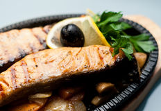 Grilled Fish Steaks and Vegetables Stock Images