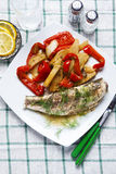 Grilled fish with sweet and sour vegetables : stewed red pepper Stock Photo