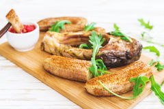 Grilled fish tilapia and chili plantains with arugula Royalty Free Stock Images