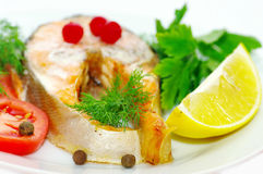 Grilled fish with vegetables. Stock Image