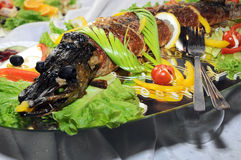 Grilled fish and vegetables Stock Images