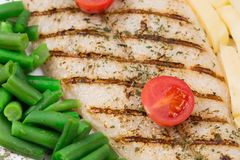Grilled fish with vegetables. Stock Photos