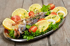 Grilled fish with vegetables and lemon Stock Photos