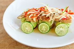 Grilled fish with vegetables and lime Stock Photos
