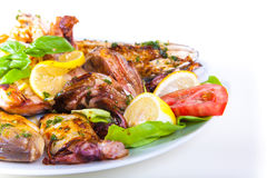 Grilled fish with vegetables on plate Isolated on Stock Images