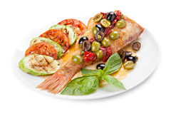 Grilled  fish with vegetables. Grilled fish  with vegetables on a plate, isolated on white background Royalty Free Stock Images