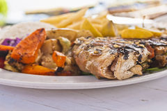 Grilled fish with vegetables Stock Images