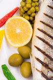Grilled fish with vegetables. Royalty Free Stock Image