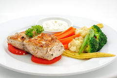 Grilled fish with vegetables Stock Image