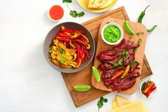 Grilled flank stake fajitas. Mexican culinary concept, view from above, space for a text royalty free stock images