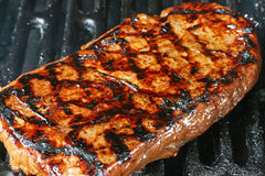Grilled flank steak. Flank steak with char marks on grill stock image