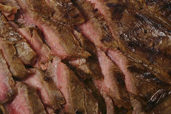 Grilled flank steak or London broil. Thinly sliced marinaded and grilled flank beef steak, or London broil as it is known in the US stock images