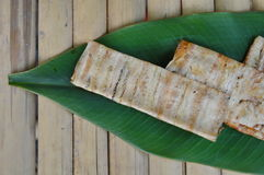 Grilled flat banana Cambodian food on banana leaf Royalty Free Stock Images