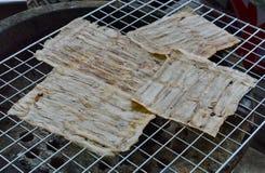 Grilled flat banana Cambodian food on gridiron Stock Photos