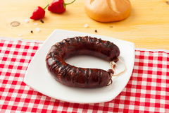 Grilled flat sausage Stock Photography