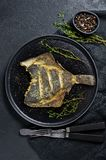 Grilled flounder, balanced healthy food. Gray background, top view, space for text. stock photo