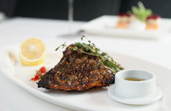 Grilled flounder with lemon and savory sauce Royalty Free Stock Photography