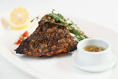 Grilled flounder with lemon and savory sauce Stock Photo