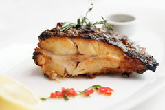 Grilled flounder with lemon and savory sauce Stock Photos