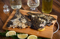 Grilled flounder on the wood Stock Photos