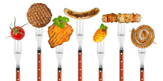 Grilled food on forks Royalty Free Stock Images