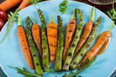 Grilled fresh carrots and asparagus Royalty Free Stock Images